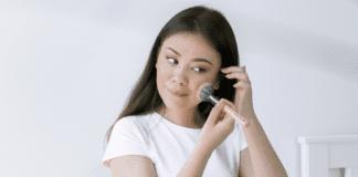 woman applying makeup on face